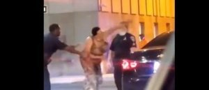 BALTIMORE: Black Woman Punches Police Officer Twice in the Face — Gets Knocked out in Street (VIDEO)