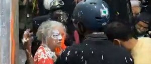 Video: Portland Rioters Throw Paint on Elderly Woman's Face for Defending Police Station