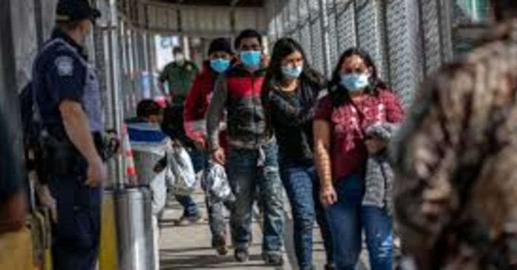 COVID Cases Explode Among Migrants Rushing Border