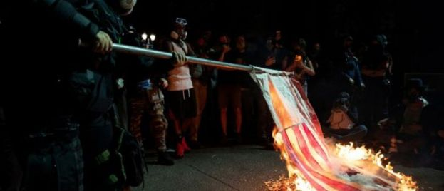 AntiFa Reveals True Intentions During BLM Riots, Burns Bibles, Flags In Portland